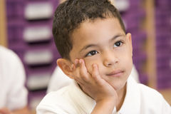 Schoolboy sitting in primary class Stock Photography