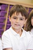 Schoolboy sitting in primary class Royalty Free Stock Photo
