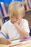A schoolboy sitting in a primary class Royalty Free Stock Photography