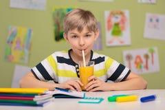 Schoolboy sitting at school desk Royalty Free Stock Photos