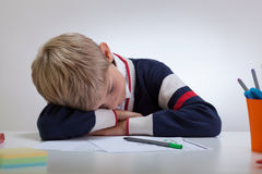 Schoolboy sleeping at the desk Royalty Free Stock Images