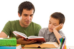 Schoolboy sleeping while his father reading. From a red color book - isolated stock images