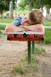 Schoolboy sleeps Stock Images
