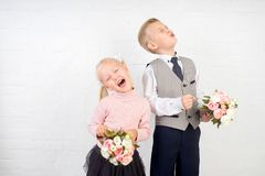 Schoolboy with small bouquet. Schoolboy schoolgirl with two small bouquets of flowers. school life concept. emotional children ready to see first teacher Stock Photo