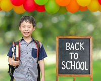 Schoolboy smiles with chalkboard Stock Photos