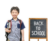 Schoolboy smiles with chalkboard Royalty Free Stock Photo