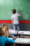 Schoolboy Solving Mathematics On Board Stock Image
