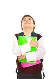 Schoolboy som ser upp arkivbild