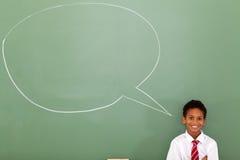 Schoolboy speech bubble. Elementary schoolboy with speech bubble drawn on chalkboard Stock Image