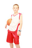 Schoolboy sportsman with the basketball. Sportsman with basketball ready to play Stock Photography