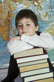 Schoolboy with a stack of books Stock Image