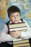 Schoolboy with a stack of books Stock Photo