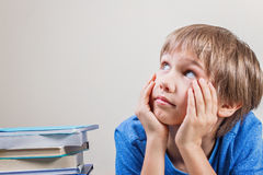Schoolboy with stack of books. Close up. Kid with stack of colorful books. Close up Royalty Free Stock Image