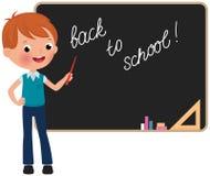 Schoolboy standing at the blackboard. Boy in school uniform standing at the blackboard Royalty Free Stock Photo