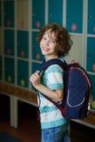 The schoolboy standing near lockers in school hallway. Royalty Free Stock Photos