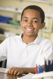 A schoolboy studying in class Royalty Free Stock Images