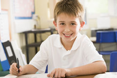 A schoolboy studying in class Stock Photography