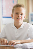 A schoolboy studying in class Stock Photos