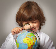 Schoolboy studying Globe Stock Images