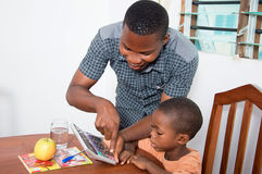 Schoolboy studying with his home teacher. The teacher shows  the keys of calculator to the schoolboy Royalty Free Stock Image