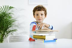 Schoolboy studying in home. Stock Images