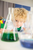 Schoolboy studying with tubes in chemical laboratory Stock Photo