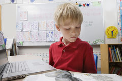 Schoolboy Studying Using a Laptop Stock Photo