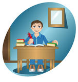 Schoolboy at the table Royalty Free Stock Image
