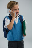 Schoolboy talking on mobile phone Stock Images