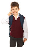 Schoolboy talking by phone mobile Stock Photography