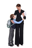 Schoolboy and teacher. Isolated white stock images