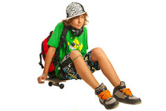 Schoolboy teen waiting on skateboard Stock Image