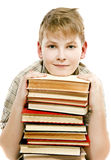Schoolboy teenager studying holding tutorials books Royalty Free Stock Photos
