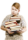 Schoolboy teenager studying holding tutorials books Stock Photo