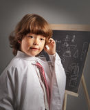 Schoolboy thought board Royalty Free Stock Images