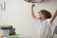 Schoolboy tired of doing lessons Stock Image