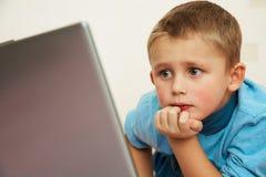 Schoolboy to laptop Stock Photo