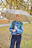 Schoolboy with umbrella Stock Photography