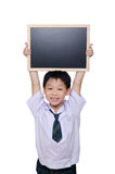 Schoolboy in uniform holding chalkboard Stock Image