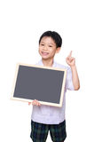 Schoolboy in uniform holding chalkboard Royalty Free Stock Photography