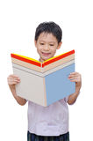 Schoolboy in uniform reading book Stock Photos