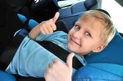 Schoolboy using child safety seat Royalty Free Stock Photography