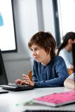 Schoolboy Using Desktop Pc In Computer Lab Stock Photo