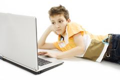 Schoolboy using a laptop Stock Photos