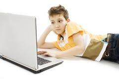 Schoolboy using a laptop Stock Photos