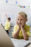 Schoolboy Using A Laptop Royalty Free Stock Image