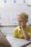 Schoolboy Using A Laptop Royalty Free Stock Photos