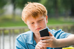 Schoolboy Using Smartphone Royalty Free Stock Images