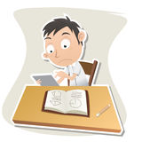 Schoolboy using tablet while studying Royalty Free Stock Images