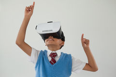 Schoolboy using virtual reality headset. Against white background Stock Photo